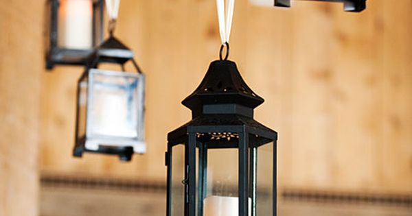 Hanging candle lanterns, strung with white ribbon, gave the voluminous space a