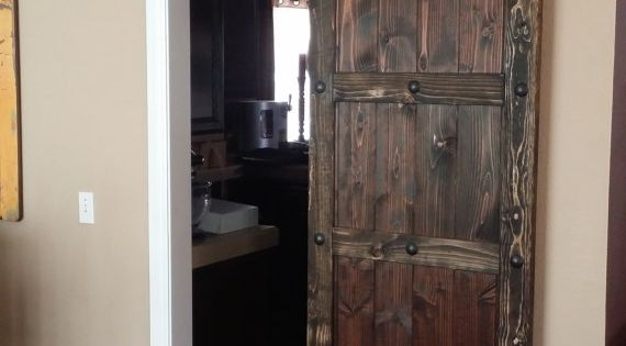 Custom Spanish Style Sliding Barn Door With Clavos