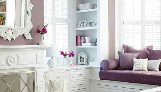 White and purple bedroom love the window seat and built in shelves