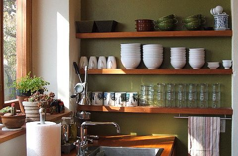 love these open shelves w/the olive wall, check out the whole kitchen