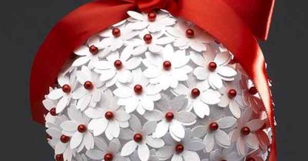 DIY Christmas Ornament. Possibly a styrofoam ball, white punched paper flowers, red
