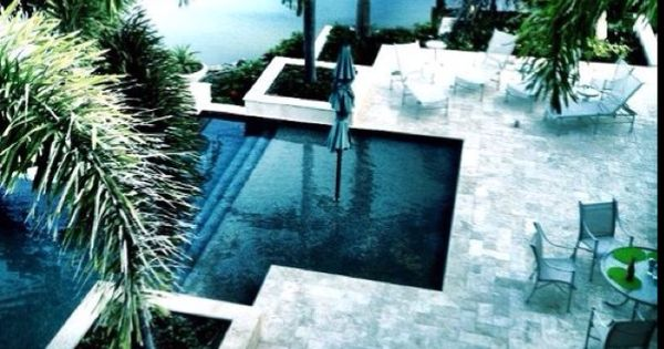 i wouldn't mind having such a beautiful pool area