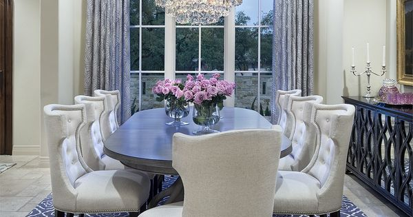 Cream-colored Dining Room With Grey Rug, Curtains And