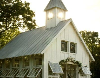 An old barn turned greenhouse. Looks like an old church to me