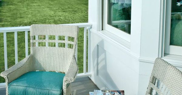 Inviting Beach House Porch With White Wicker Furniture And