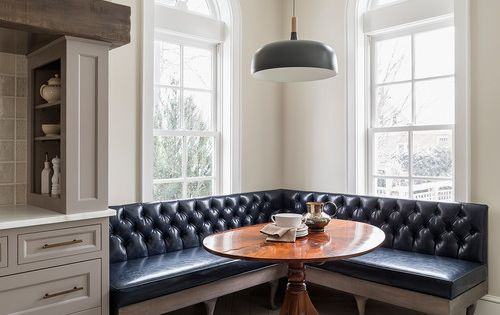 Banquette With Tufted Leather And A Round Table Spaces