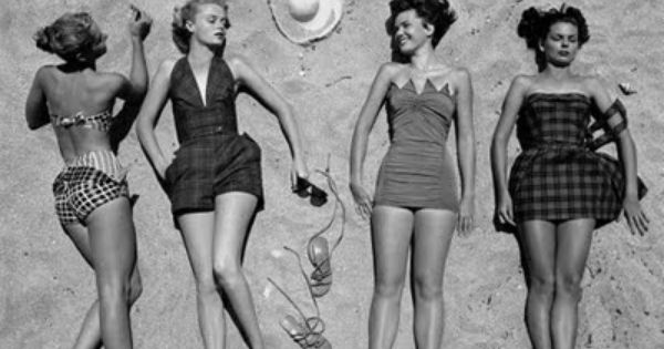 vintage sunbathers - girlfriends soaking up the sun at the beach