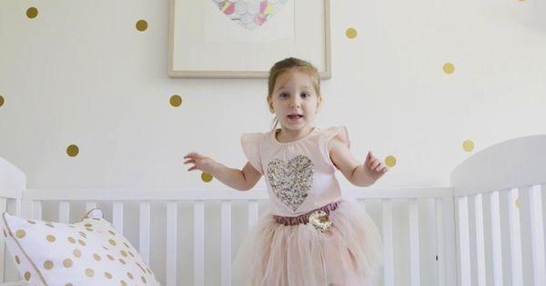 Eliora s white pastel and gold bedroom polka dot walls tassel garland and garlands