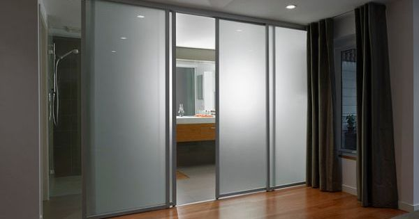 Frosted glass sliding doors separate the contemporary
