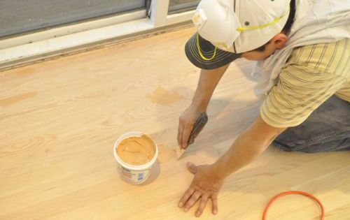 After sanding the guys used woodwise wood filler to fill for Wood floor hole filler