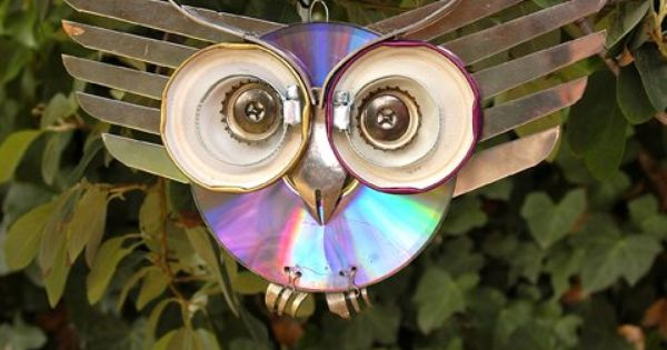 This owl was made from salvaged kitchen supplies and a CD which