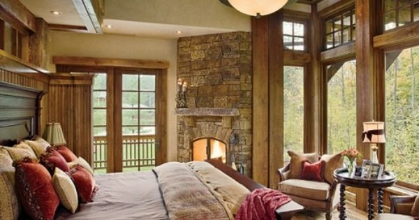 love the stone, fireplace, big windows, french doors