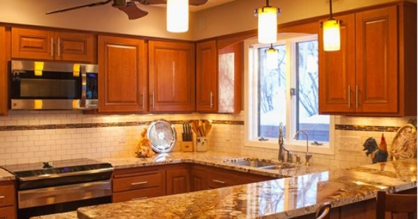 Warm and inviting kitchen with refinished cabinets creative