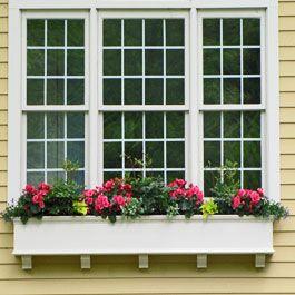 Extra Long Window Box With Corbels Underneath Triple Window