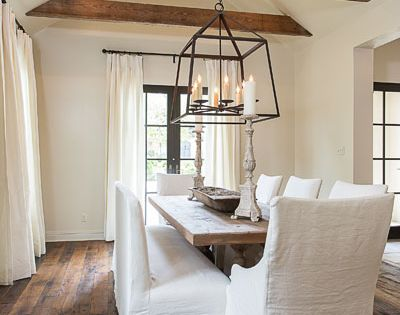 Chic Rustic Dining Room With Vaulted Ceiling Accented With