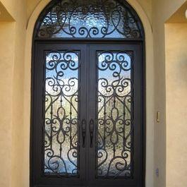 Spanish Arched Double Entry Doors Double Iron Door With Transom Iron Front Door Iron Doors Mediterranean Front Doors