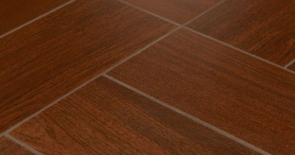 If you want that wood look in your bathroom but want the for Porcelain floor tile durability