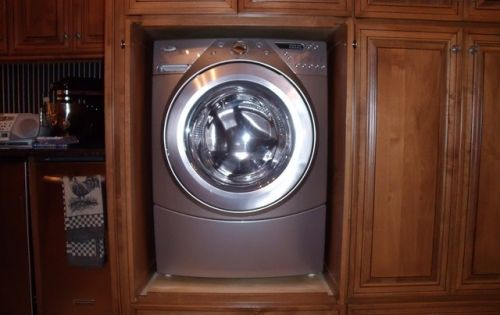 built ins with flipper doors to hide washer and dryer stacking washer dryer pinterest. Black Bedroom Furniture Sets. Home Design Ideas
