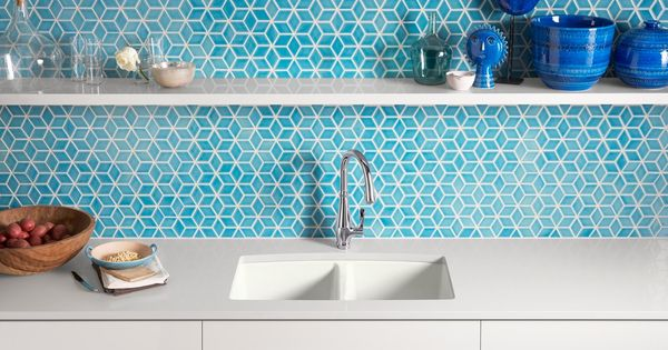 Bright blue tiles serve as a vibrant backdrop to the crisp Bright blue tile