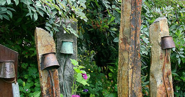 Rustic garden lighting. Old galvanized buckets turned upside down to house the