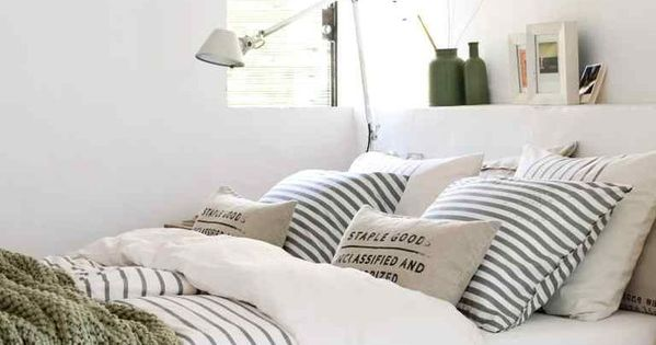 Bright White Bedroom With Black And White Striped Bedding