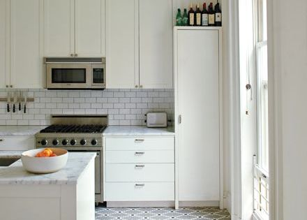 full height effect, patterned tile flooring,classic subway tile and a killer pendant,
