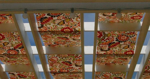 Pergola With Outdoor Fabric Strips Woven Through The Top