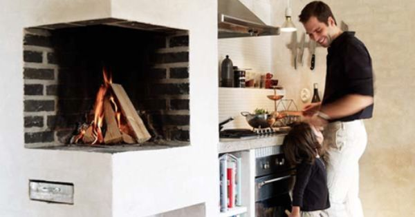 Great simple rustic kitchen with the added benefit of a fireplace