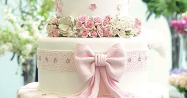3 tier wedding cake with pink fondant flowers and cute pink fondant