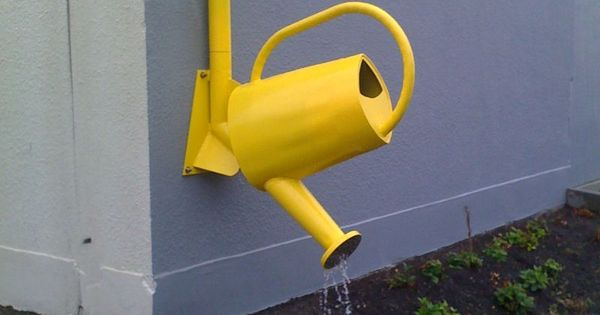 Drain spout via a sunny yellow watering can...so cute! All it needs