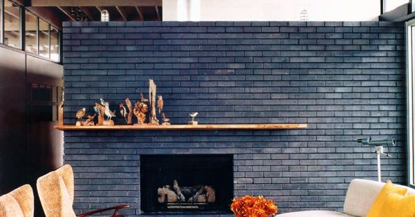 black brick fireplace wall - paint the brick