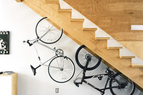 Interior:Amazing Storage Space Under The Stairs With Bicycles Are Hung Under The