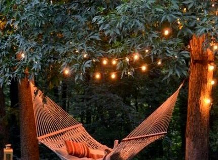 Backyard hammock plus tree lights makes magic on warm summer nights