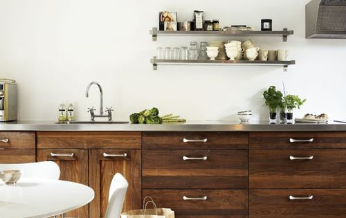 Dark Raw Wood Cabinets With A Stainless Steel Countertop