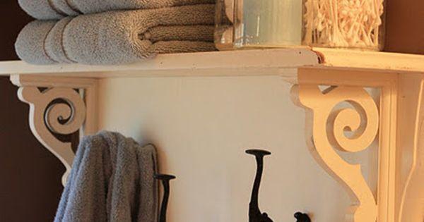 twin headboard turned shelf, for the towel rack area... sorta love this
