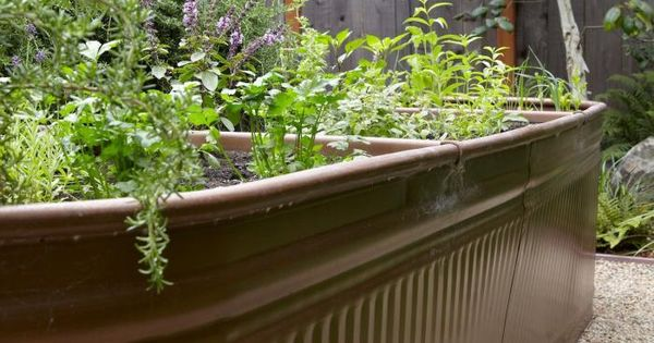 Steal This Look Water Troughs As Raised Garden Beds