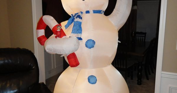 Elf on the Shelf brought in an 8 foot outdoor snowman into