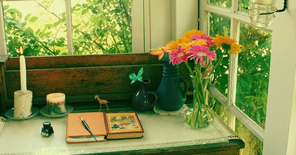 perfect spot for a writing desk, open windows with lots of greenery.