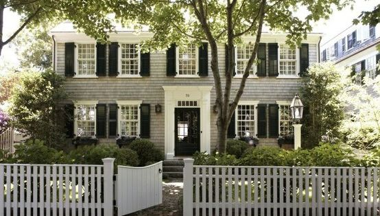 Colonial with gray shingles, black shutters and white picket fence. Love this