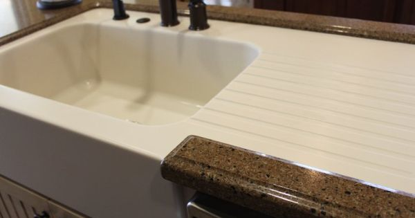 Custom made corian farm sink with drainboard in a hanstone for Corian farm sink price