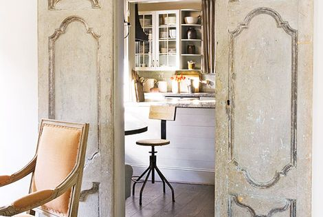 antique doors put on rollers are now sliding doors - I love