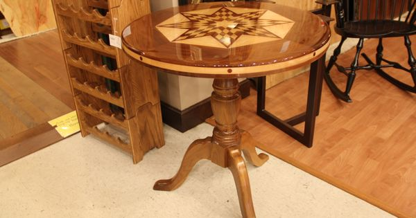 A Beautifully Designed Wooden Table With Gorgeous Detail