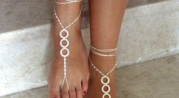 Women Wearing Barefoot Sandals | ivory, Barefoot Sandals, bead, barefoot sandles, wedding, Bikini ... | See more about Barefoot, Sandals and Wedding Bikini.