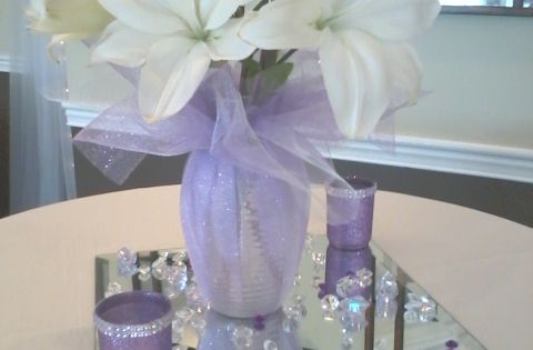 Large Flowers In Vase Wrapped With Pink Or Purple Colored Tulle Organza And Ribbon Two Or Three
