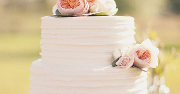simple two tier wedding cake with ranunculus and garden roses -