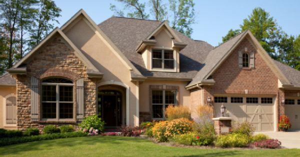 Stucco brick rock exterior mixed material home design for Mixing brick and stone exterior