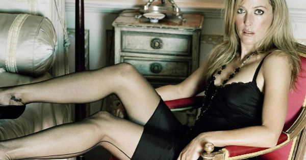 Gillian Anderson leggy in a slip and seamed stockings and ...