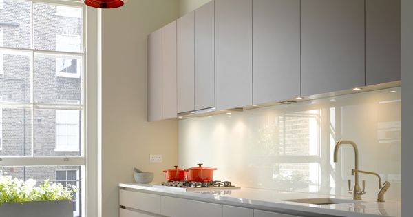 Roundhouse bespoke Urbo kitchen in a galley layout. Copper hanging light. Herringbone ...