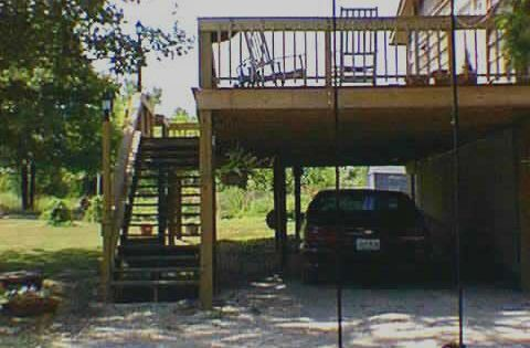 Carport with above deck under trees google search home for Carport deck combination