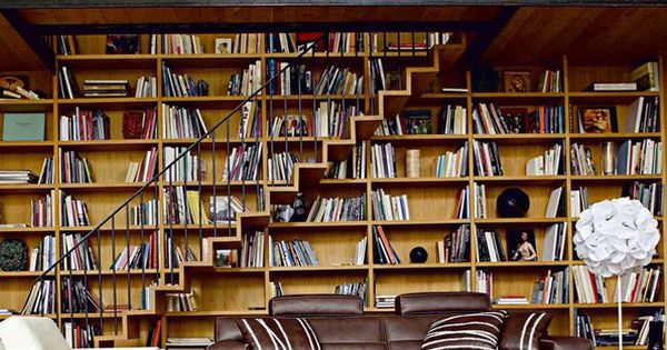 Book shelve behind the stairs, needs more books though!